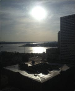 "View of sun rising over Mississippi River from my hotel room in New Orleans after my ""all nighter."""